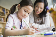 Mother and daughter coloring with markers - HEROF04453