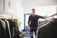 Portrait of business owner in clothing store - HEROF04480