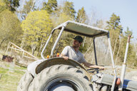 Mid adult man on tractor in Sweden - FOLF09694