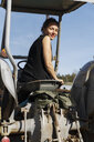 Mid adult woman on tractor in Sweden - FOLF09703