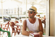 Mid adult man sitting outdoors at a cafe in Fuengirola, Spain - FOLF09733
