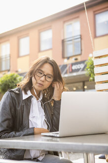 Young woman using her laptop in Solvesborg, Sweden - FOLF09742