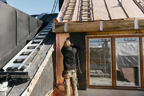 Roofer working on a building in Stockholm, Sweden - FOLF09901