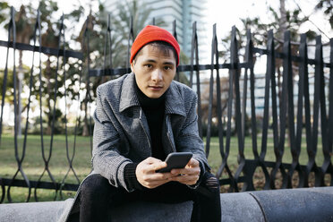 Spain, Barcelona, portrait of fashionable young man with cell phone - JRFF02489