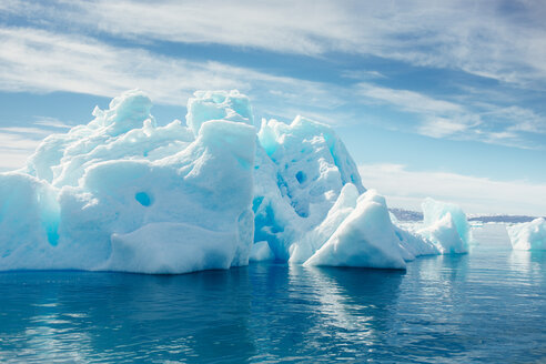 Majestic icebergs floating on sea against cloudy sky - ASTF01944