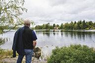 Senior man standing by lake in Falun, Sweden - FOLF10109