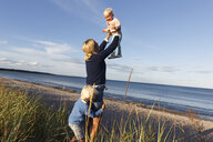 Family playing at beach in Gotland, Sweden - FOLF10208