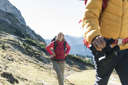 Austria, Tyrol, smiling woman with man hiking in the mountains - UUF16337
