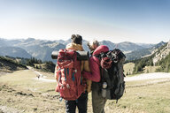 Austria, Tyrol, rear view of couple on a hiking trip in the mountains enjoying the view - UUF16343