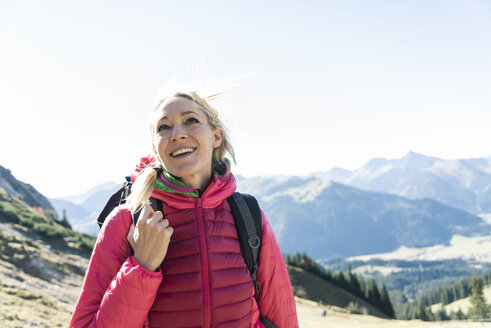 Austria, Tyrol, happy woman on a hiking trip in the mountains - UUF16349
