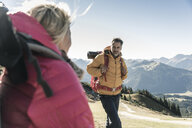 Austria, Tyrol, man with woman hiking in the mountains - UUF16361