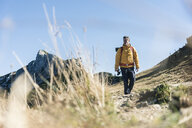Austria, Tyrol, man hiking in the mountains - UUF16367