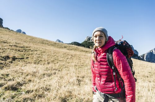 Austria, Tyrol, smiling woman on a hiking trip in the mountains - UUF16385