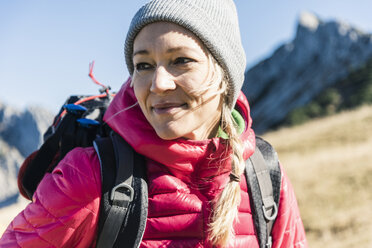 Austria, Tyrol, portrait of smiling woman on a hiking trip in the mountains - UUF16388