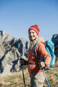 Austria, Tyrol, smiling woman on a hiking trip in the mountains - UUF16409