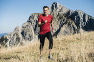 Austria, Tyrol, man running in the mountains - UUF16412