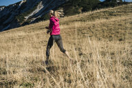 Austria, Tyrol, woman running in the mountains - UUF16421