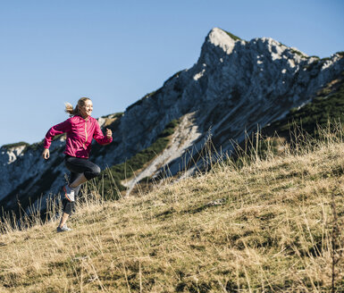 Austria, Tyrol, woman running in the mountains - UUF16427