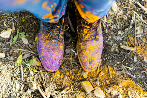 Shoes of a person covred in powderb paint, celebrating Holi, Festival of colors - ERRF00468