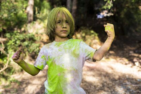 Boy full of colorful powder paint, celebrating Holi, Festival of Colors - ERRF00486