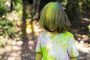 Boy full of colorful powder paint, celebrating Holi, Festival of Colors - ERRF00489