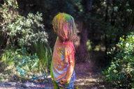 Boy full of colorful powder paint, celebrating Holi, Festival of Colors - ERRF00495