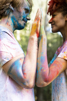 Affectionate couple celebrating Holi, Festival of Colors - ERRF00510
