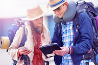 Backpacker couple using digital tablet - CUF46575