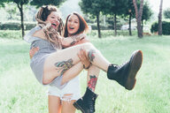 Girlfriends playing in park - CUF46662