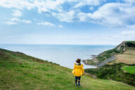 Boy on clifftop looking out to sea, Bournemouth, UK - CUF46722