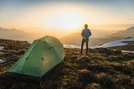 Hiker camping on French Alps, Parc naturel régional du Massif des Bauges, Chatelard-en-Bauges, Rhone-Alpes, France - CUF46893