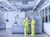 Chemists working in industrial laboratory, wearing protective clothing in the clean room - CVF01094