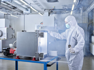 Chemist working in industrial laboratory clean room - CVF01100