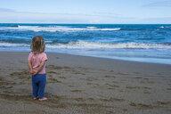 Spain, Canary Islands, Fuerteventura, La Pared, Playa del Viejo Rey, little girl standing on the beach - RUNF00855