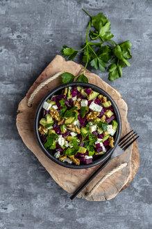 Bowl of beetroot salad with avocado, feta, walnuts and parsley - SARF04053
