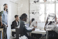 Multi-ethnic entrepreneurs in board room during business meeting - MASF10751