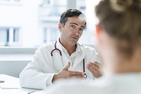 Portrait of doctor talking to patient in medical practice - JOSF02784
