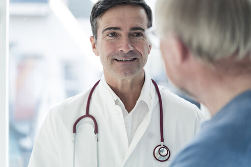 Portrait of smiling doctor looking at patient - JOSF02787