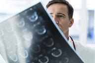 Doctor examining MRT image in medical practice - JOSF02805