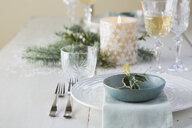 Holly and place setting on Christmas table - HEROF04617