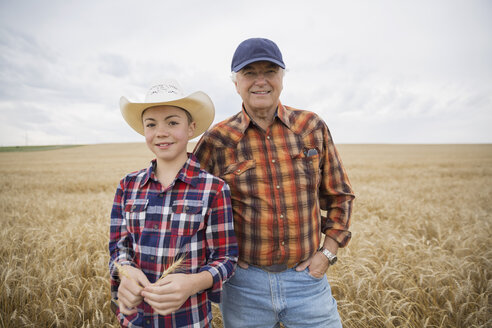 Portrait of grandfather and grandson in wheat field - HEROF04785