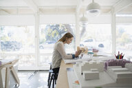 Female architect working at laptop in office - HEROF04962