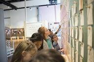 Children looking up at exhibit display in science center - HEROF05199