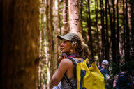 Friends hiking in forest, Johnstone Strait, Telegraph Cove, Canada - CUF46949
