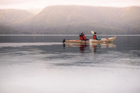 Friends kayaking in lake, Johnstone Strait, Telegraph Cove, Canada - CUF47057