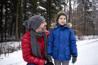 Father and son together in winter forest - ABIF01125