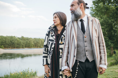 Couple standing by lake - CUF47321