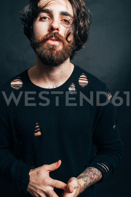 Portrait of hipster in torn top - CUF47387