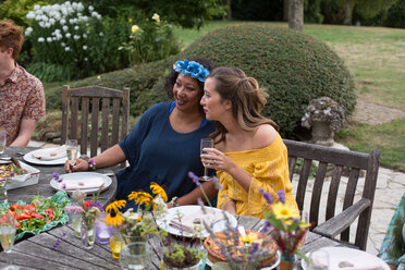 Guests enjoying and celebrating at garden party - CUF47444