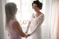 Bride and mother on morning of wedding day - CUF47456